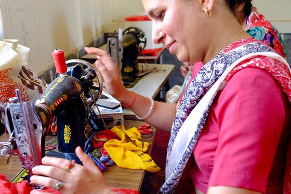 Stand ethical fashio and textiles women sewing
